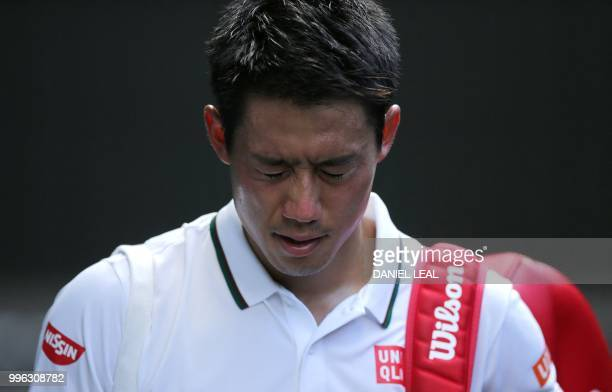 TOPSHOT Japan's Kei Nishikori leaves centre court after losing to Serbia's Novak Djokovic 63 36 62 62 in their men's singles quarterfinals match on...