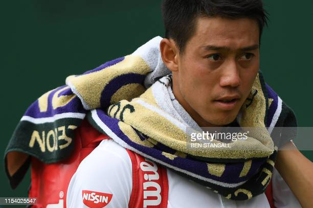 Japan's Kei Nishikori leaves the court after beating US player Steve Johnson during their men's singles third round match on the sixth day of the...