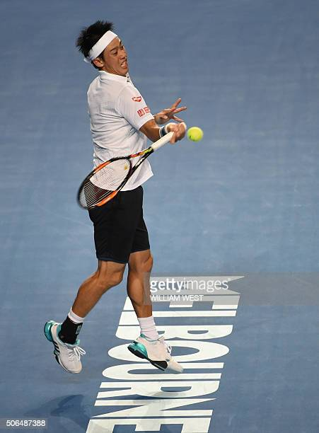 Japan's Kei Nishikori plays a forehand return during his men's singles match against France's Jo-Wilfried Tsonga on day seven of the 2016 Australian...