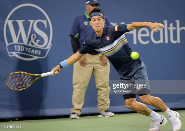 Japan's Kei Nishikori reaches for the ball during a secondround match against Switzerland's Stan Wawrinka at the Western amp Southern Open in...