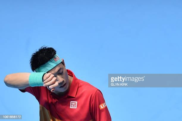 Japan's Kei Nishikori reacts after a point against Austria's Dominic Thiem during their men's singles roundrobin match on day five of the ATP World...