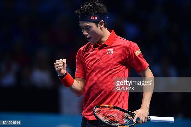 Japan's Kei Nishikori reacts after a point against Croatia's Marin Cilic during their round robin stage men's singles match on day six of the ATP...