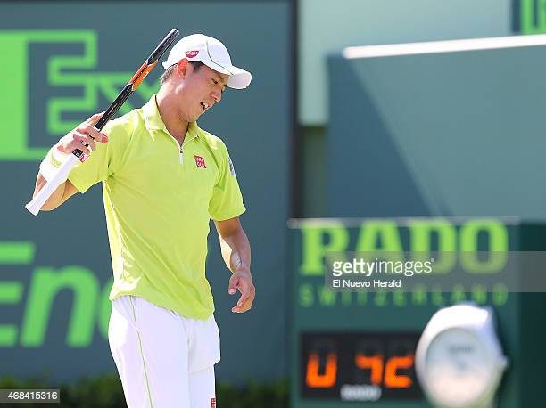Japan's Kei Nishikori reacts after a point during action against the United States' John Isner in the semifinals of the Miami Open at Crandon Park in...