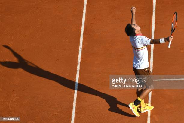 TOPSHOT Japan's Kei Nishikori reacts after victory over Croatia's Marin Cilic during their tennis match at the MonteCarlo ATP Masters Series...
