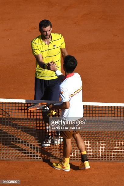 Japan's Kei Nishikori reacts after victory over Croatia's Marin Cilic during their tennis match at the MonteCarlo ATP Masters Series tournament on...