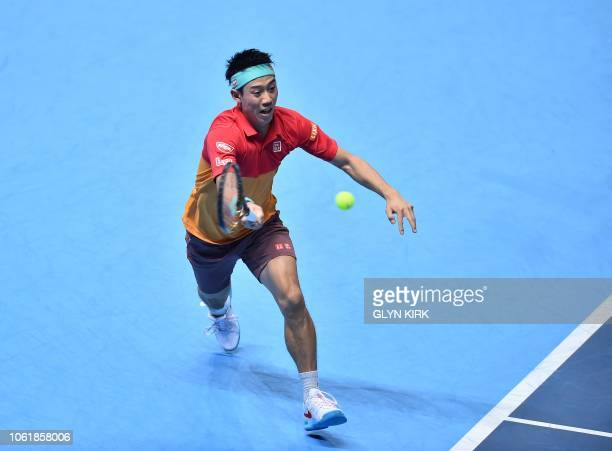 Japan's Kei Nishikori returns against Austria's Dominic Thiem during their men's singles roundrobin match on day five of the ATP World Tour Finals...