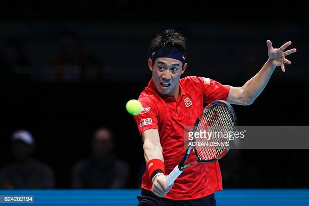 Japan's Kei Nishikori returns against Croatia's Marin Cilic during their round robin stage men's singles match on day six of the ATP World Tour...