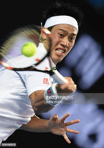 Japan's Kei Nishikori returns against France's Jo-Wilfried Tsonga during their men's singles on day seven of the 2016 of the Australian Open tennis...