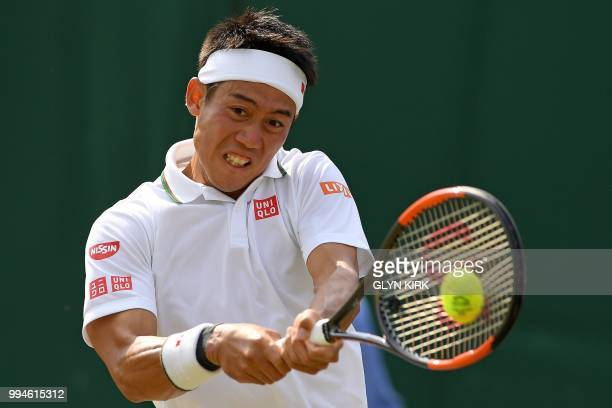 Japan's Kei Nishikori returns against Latvia's Ernests Gulbis during their men's singles fourth round match on the seventh day of the 2018 Wimbledon...
