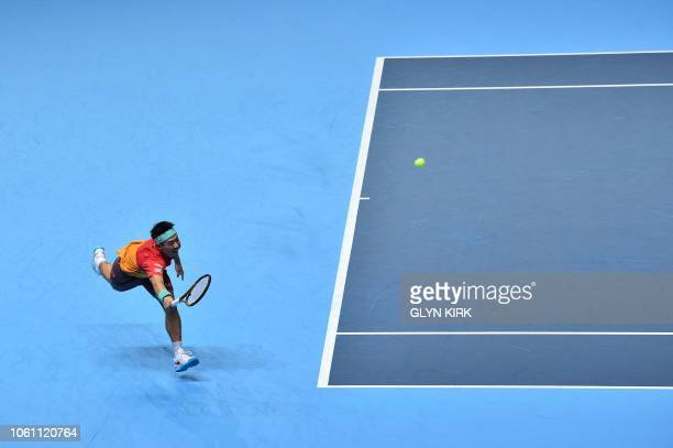 Japan's Kei Nishikori returns against South Africa's Kevin Anderson during their men's singles roundrobin match on day three of the ATP World Tour...
