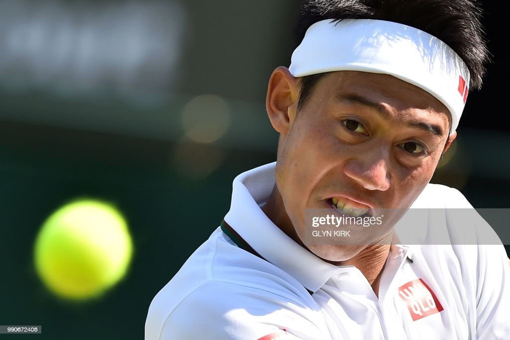 Japan's Kei Nishikori returns against US player Christian Harrison during their men's singles first round match on the second day of the 2018 Wimbledon Championships at The All England Lawn Tennis Club in Wimbledon, southwest London, on July 3, 2018. - Nishikori won the match 6-2, 4-6, 7-6, 6-2. (Photo by Glyn KIRK / AFP) / RESTRICTED