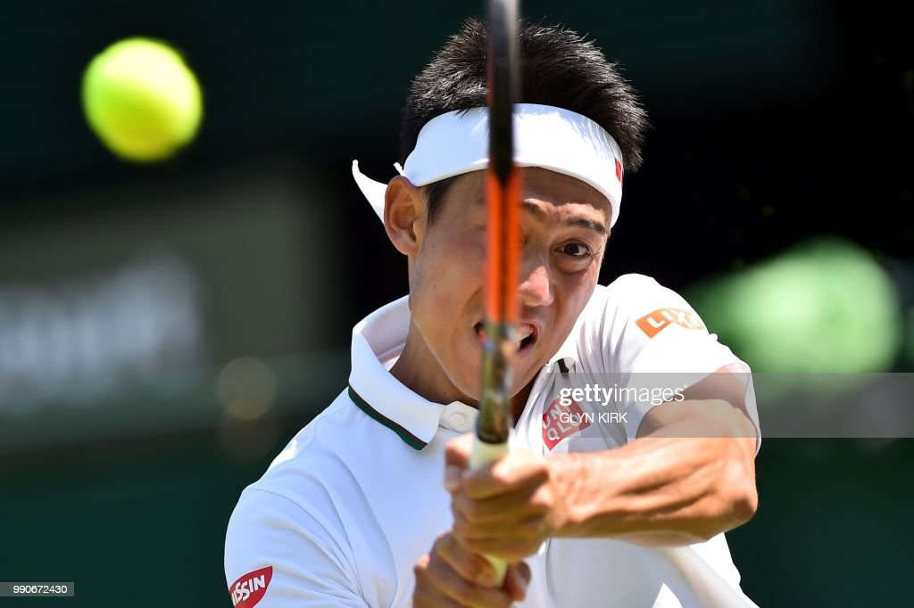 TOPSHOT - Japan's Kei Nishikori returns against US player Christian Harrison during their men's singles first round match on the second day of the 2018 Wimbledon Championships at The All England Lawn Tennis Club in Wimbledon, southwest London, on July 3, 2018. - Nishikori won the match 6-2, 4-6, 7-6, 6-2. (Photo by Glyn KIRK / AFP) / RESTRICTED