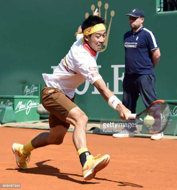 Japan's Kei Nishikori returns the ball against Croat Marin Cilic in a quarterfinal of the MonteCarlo Masters in Monaco on April 20 2018 Nishikori won...