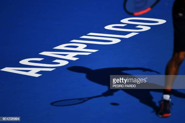 TOPSHOT Japan's Kei Nishikori returns the ball during an exibition match the day before the start of the Mexico ATP 500 Tennis Open in Acapulco...