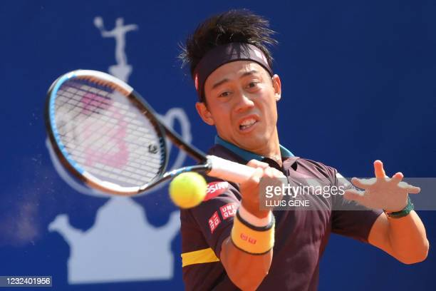 Japan's Kei Nishikori returns the ball to Argentina's Guido Pella during their ATP Barcelona Open tennis tournament singles match at the Real Club de...