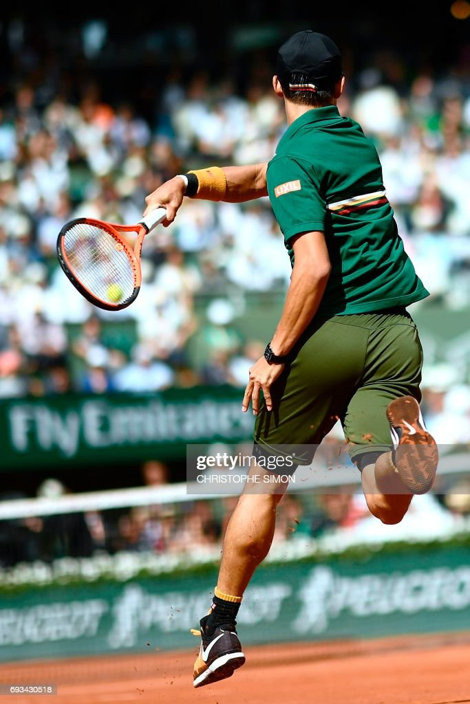 Japan's Kei Nishikori returns the ball to Britain's Andy Murray during their tennis match at the Roland Garros 2017 French Open on June 7, 2017 in Paris. /