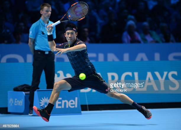 Japan's Kei Nishikori returns the ball to Czech Republic's Tomas Berdych during their men's singles group stage match on day three of the ATP World...