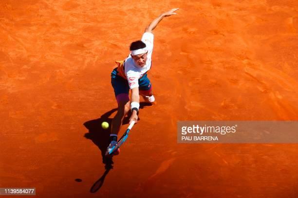 Japan's Kei Nishikori returns the ball to Russia's Daniil Medvedev during their ATP Tour Barcelona Open semi-final tennis match in Barcelona on April...