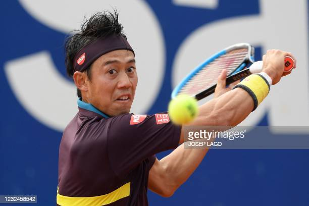 Japan's Kei Nishikori returns the ball to Spain's Rafael Nadal during their ATP Barcelona Open tennis tournament singles match at the Real Club de...