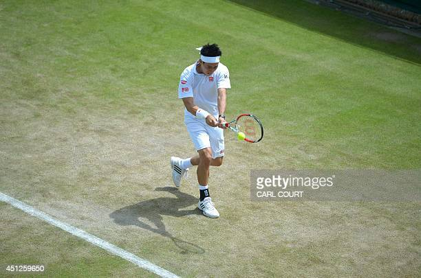 Japan's Kei Nishikori returns to US player Denis Kudla during their men's singles second round match on day four of the 2014 Wimbledon Championships...