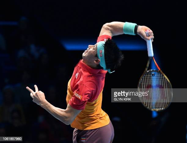 Japan's Kei Nishikori serves against Austria's Dominic Thiem during their men's singles roundrobin match on day five of the ATP World Tour Finals...