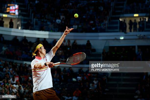 TOPSHOT Japan's Kei Nishikori serves against Serbia's Novak Djokovic during their quarter final match at Rome's ATP Tennis Open tournament at the...