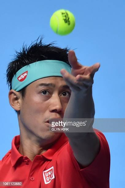 Japan's Kei Nishikori serves against South Africa's Kevin Anderson during their men's singles roundrobin match on day three of the ATP World Tour...