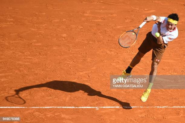 Japan's Kei Nishikori serves to Croatia's Marin Cilic during their tennis match at the MonteCarlo ATP Masters Series tournament on April 20 2018 in...