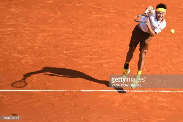 TOPSHOT Japan's Kei Nishikori serves to Croatia's Marin Cilic during their tennis match at the MonteCarlo ATP Masters Series tournament on April 20...