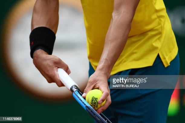 Japan's Kei Nishikori serves to France's Quentin Halys during their men's singles first round match on day 1 of The Roland Garros 2019 French Open...