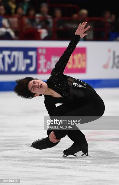 Japan's Keiji Tanaka performs his men's short program routine at the World Figure Skating Championships on March 22 2018 in Milan / AFP PHOTO /...
