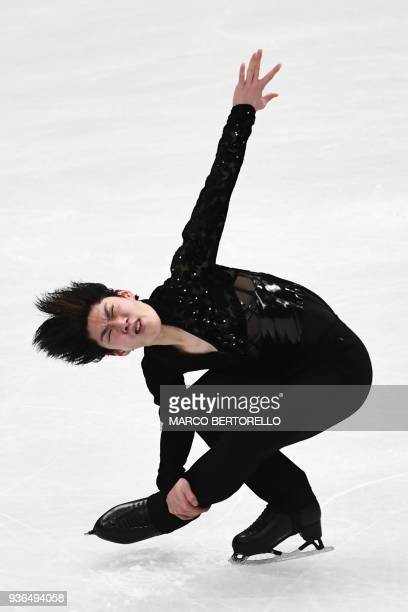 Japan's Keiji Tanaka performs his men's short program routine at the World Figure Skating Championships on March 22 2018 in Milan / AFP PHOTO / MARCO...