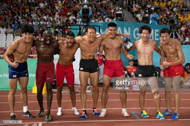 Japan's Keisuke Ushiro celebrates with other athletes after winning the men's 1500m decathlon athletics event during the 2018 Asian Games in Jakarta...