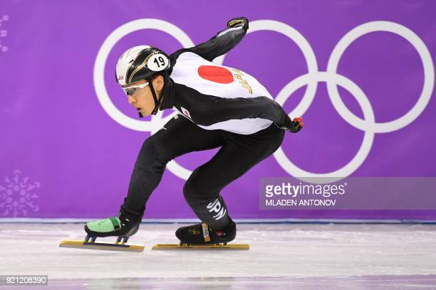 Japan's Keita Watanabe competes in the men's 500m short track speed skating heat event during the Pyeongchang 2018 Winter Olympic Games at the...