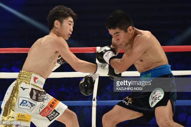 TOPSHOT Japan's Ken Shiro and Mexico's Ganigan Lopez fight during their WBC world light flyweight title boxing bout in Tokyo on May 25 2018