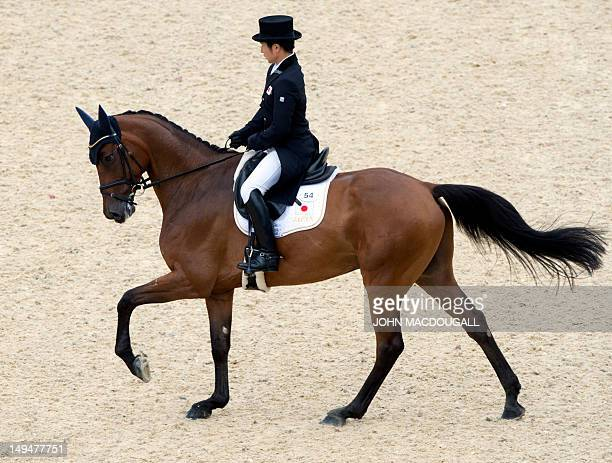 Japan's Kenki Sato on Chippieh competes in the dressage event of the eventing competition at the London 2012 Olympic Games in Greenwich Park London...