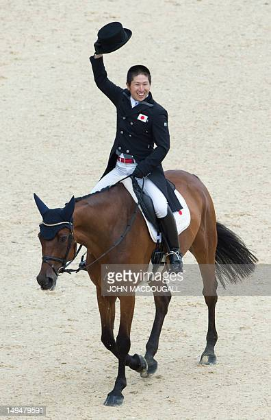 Japan's Kenki Sato on Chippieh salutes the crowd in the Dressage phase of the Eventing competition of the 2012 London Olympics at the Equestrian...