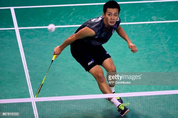 Japan's Kenta Nishimoto competes against India's Srikanth Kidambi during their men's singles final match at the French Open Badminton tournament at...