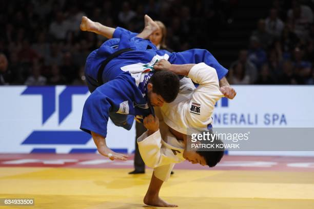 Japan's Kentaro Ilda fights against French Cyrille Maret during the man 100 kg final on February 12 2017 at the Accor Hotels Arena in Paris during...