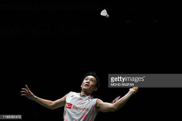 Japan's Kento Momota eyes a return against Denmark's Viktor Axelsen during their men's singles final match at the Malaysia Open badminton tournament...
