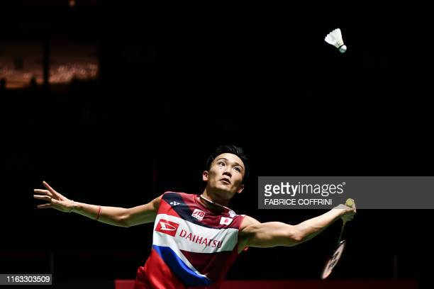 Japan's Kento Momota eyes the shuttlecock during his men's singles quarter-final match against Malaysia's Lee Zii Jia at the 2019 BWF Badminton World...