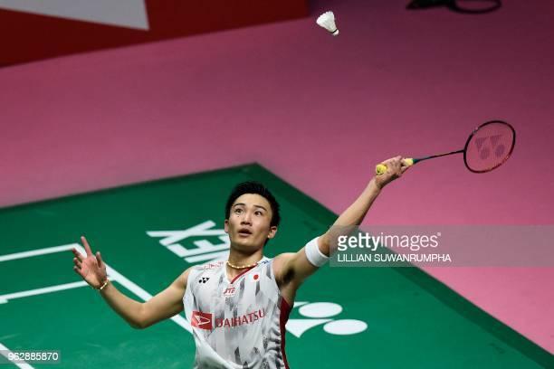 Japan's Kento Momota hits a return against China's Chen Long during their mens singles final match at the Thomas Cup badminton tournament in Bangkok...