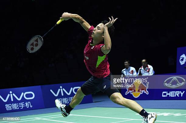 Japan's Kento Momota hits a return against South Korea's WanHo Son during their men's singles semifinal match of the 2015 Sudirman Cup world...