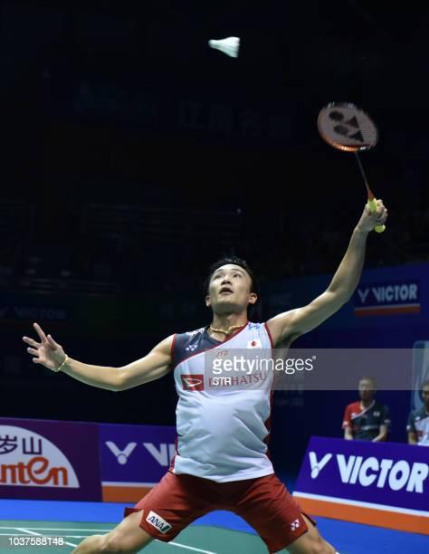 Japan's Kento Momota hits a return towards China's Shi Yuqi during the men's semifinal match of the China Open 2018 badminton tournament in Changzhou...
