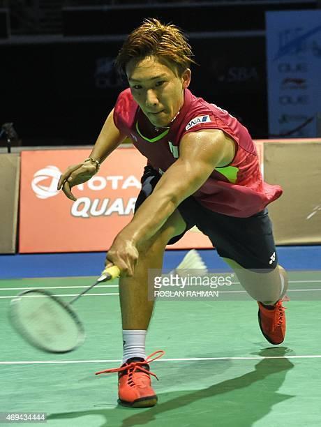 Japan's Kento Momota plays against Hong Kong's Hu Yun in their men's single final at the Singapore Open badminton tournament on April 12 2015 AFP...