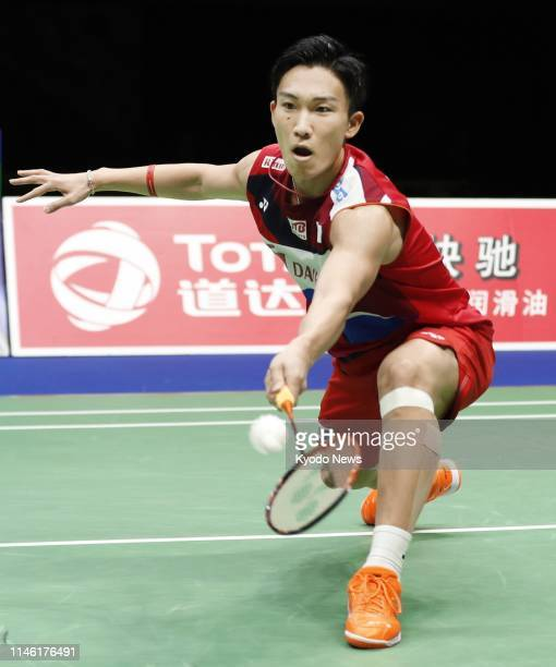 Japan's Kento Momota plays against Indonesia's Anthony Sinisuka Ginting in the semifinals of the Sudirman Cup mixed team badminton tournament in...