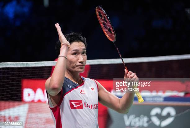 Japan's Kento Momota reacts after winning against Chou Tien Chen of Taiwan in their Men's Singles final match at the DANISA Denmark Open 2018...