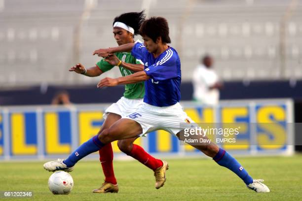 Japan's Kohei Kudo and Mexico's Jose Luis Mendoza battle for the ball