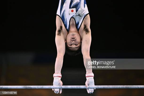 Japan's Kohei Uchimura competes in the horizontal bars event of the artistic gymnastics men's qualification during the Tokyo 2020 Olympic Games at...