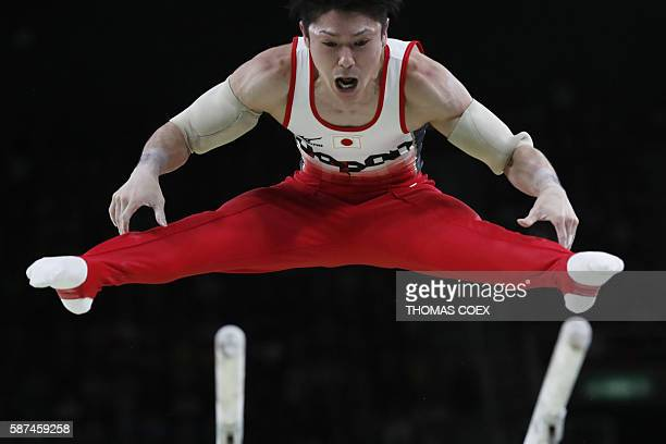 TOPSHOT Japan's Kohei Uchimura competes in the parallel bars of the men's team final of the Artistic Gymnastics at the Olympic Arena during the Rio...